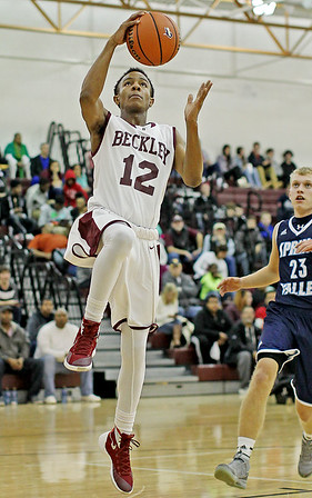 Woodrow Wilson's Tyriek Walton (12) goes up for a layup on a fast break during the first quarter of their basketball game against Spring Valley Thursday in Beckley.