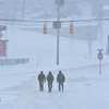 Brad Davis/The Register-Herald<br /> The view down Neville Street towards Robert C. Byrd Drive as a trio of pedestrians make their way toward the desolate intersection around 10:50 a.m. Saturday.