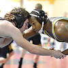 Brad Davis/The Register-Herald<br /> Greenbrier East's Leslie Campbell takes on Preston's Alec Cress in a 160-pound weight class matchup Friday afternoon at the Beckley-Raleigh County Convention Center. Campbell would go on to win the match.