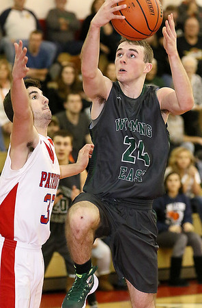 Brad Davis/The Register-Herald<br /> Wyoming East's Logan Blankenship drives and scores as Independence's Logan Kelly tries to stop him during the Warriors' win over the Patriots Saturday night in Coal City.
