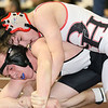 Brad Davis/The Register-Herald<br /> Oak Hill's Keith Pecora takes on Preston's Christian Radabaugh in a 138-pound weight class matchup Saturday afternoon at the Beckley-Raleigh County Convention Center. Radabaugh would go on to win the match.