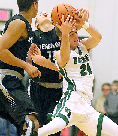 Brad Davis/The Register-Herald<br /> Wyoming East's Logan Blankenship nearly collides mid-air with Westside's Tre Colucci, left, and Isaiah Lester as the three leap for a long pass during the Warriors' win over the Renegades Friday night in New Richmond.