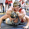Brad Davis/The Register-Herald<br /> Liberty's Eric Workman takes on North Marion's Chance Haught in a 170-pound weight class matchup Friday afternoon at the Beckley-Raleigh County Convention Center. Haught would go on to win the match.