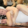 Brad Davis/The Register-Herald<br /> Oak Hill's Moses Truman (top) takes on Preston's Branson Tasker in a 145-pound weight class matchup Saturday afternoon at the Beckley-Raleigh County Convention Center. Truman would pin Tasker to win the match.