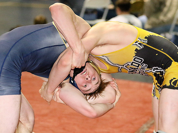 Brad Davis/The Register-Herald<br /> Shady Spring's Zach Clark takes on Keyser's Shayden Daugherty in a 152-pound weight class matchup Saturday afternoon at the Beckley-Raleigh County Convention Center. Daugherty would go on to win the match.