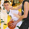 Brad Davis/The Register-Herald<br /> Wyoming East's David Carte works underneath as Westside's Cory Hatfield defends during the Warriors' win over the Renegades Friday night in New Richmond.