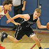 Brad Davis/The Register-Herald<br /> Liberty's Tanner Cantley tries to get around Independence's Chris Mills while moving the ball up the court during the Raiders' loss to the Patriots Saturday night in Coal City.
