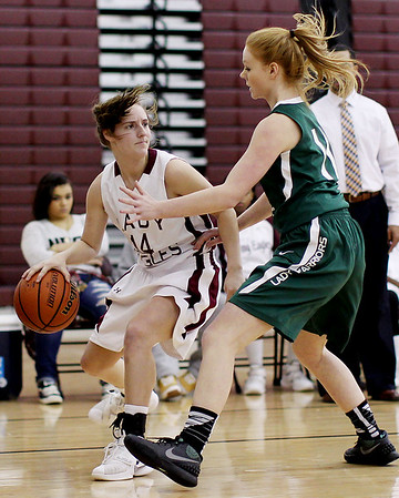 Woodrow Wilson's Lyric Moon (14) looks to pass to a teammate as Wyoming East's Megan Davis (11) guards her during their basketball game Monday in Beckley.
