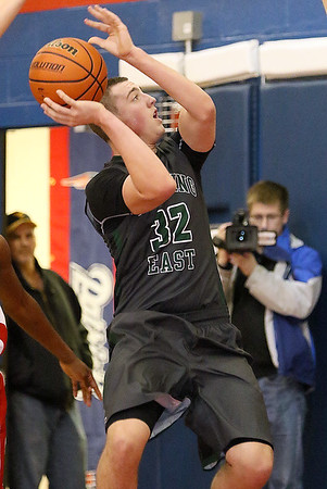 Brad Davis/The Register-Herald<br /> Wyoming East's Dylan Brehm drives to the basket during the Warriors' win over Independence Saturday night in Coal City.