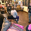 Brad Davis/The Register-Herald<br /> LA East Fitness owner David Chinn, right, speaks to winners of a free year of membership during an introduction meeting at the 122 Appalachian Drive gym Wednesday night. Winners were chosen from a pool of 16 applicants who sent in essays explaining their reasons for wanting to get in better shape and transition to a healthier lifestyle.
