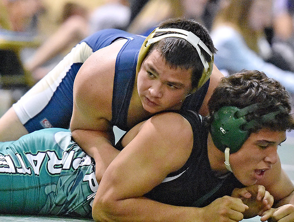 Brad Davis/The Register-Herald<br /> Shady Spring's Shane Scarbro takes on Fayetteville's Christian Lively in a 195-pound weight class matchup Friday afternoon at the Beckley-Raleigh County Convention Center. Scarbro would go on to win the match.