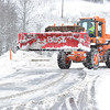 Brad Davis/The Register-Herald<br /> West Virginia Parkways Authority worker James Shuck turns back for more as he works to clear the driveways around Tamarack in a massive bulldozer Saturday afternoon.