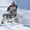 Brad Davis/The Register-Herald<br /> An ATV rider is caught by the camera as he tears through the snow on his way to a nearby trail in near Lester during a sunny Sunday afternoon.