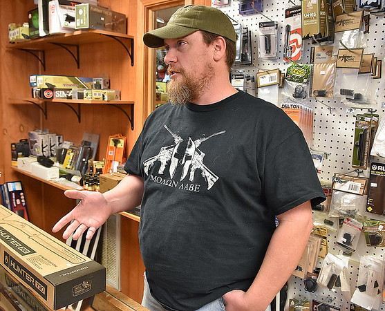 Brad Davis/The Register-Herald<br /> Shooter's Roost owner Eric Stratton discusses President Barack Obama's executive actions expanding background checks for gun sales during a Register-Herald visit to the Eisenhower Drive business Wednesday afternoon.