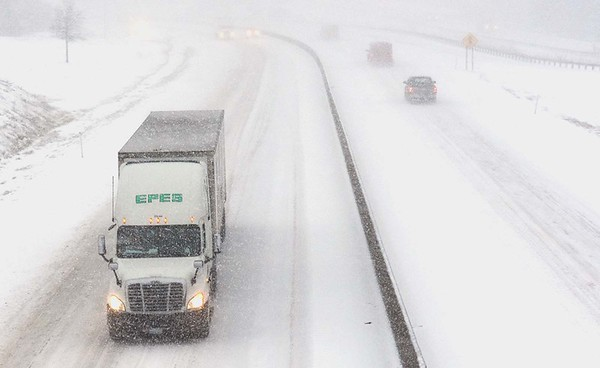 Rick Barbero/The Register-Herald<br /> WV turnpike in Beckley is covered up with snow from the winter storm that hit the area Friday morning.