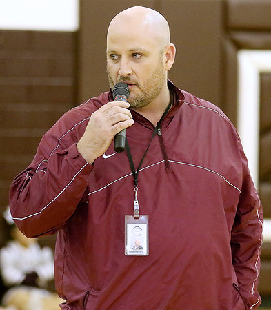 """Brad Davis/The Register-Herald<br /> Chad """"Street"""" Sarrett, Woodrow Wilson's newly named football coach, addresses the crowd with a brief halftime speech during the Flying Eagles' boys basketball game against Winfield January 14."""