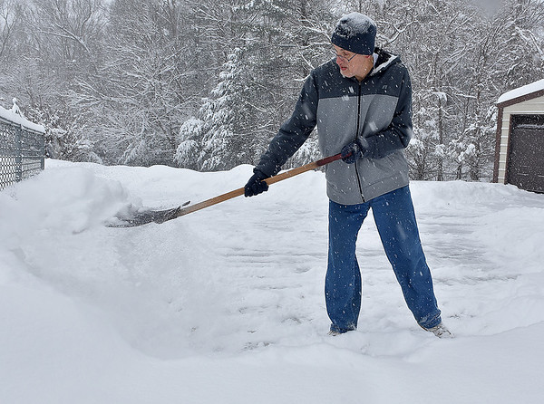 Brad Davis/The Register-Herald<br /> Beckley resident John Bullick does what practically everyone had to do again on Saturday as he shovels snow from the driveway of his Maxwell Hill Road home.