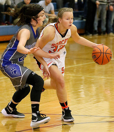 Brad Davis/The Register-Herald<br /> Summers County's Whittney Justice drives to the basket as Princeton's Jamie Vest defends Saturday afternoon in Hinton.