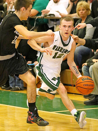 Brad Davis/The Register-Herald<br /> Wyoming East's Johnathan Sims drives around Westside's Shane Jenkins during the Warriors' win over the Renegades Friday night in New Richmond.