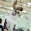Woodrow Wilson's Marcus Christian (20) goes up for a layup during the first quarter of their basketball game against Spring Valley Thursday in Beckley.
