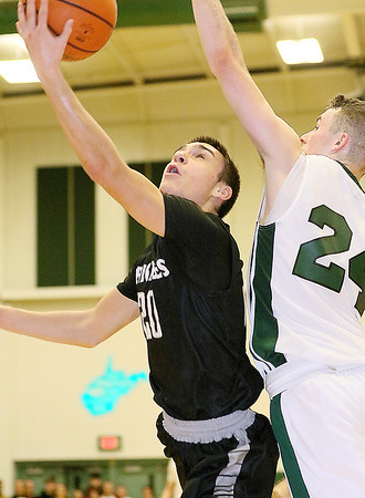 Brad Davis/The Register-Herald<br /> Westside's Shane Jenkins drives to the basket as Wyoming East's Logan Bankenship defends Friday night in New Richmond.