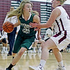 Wyoming East's Gabby Lapardus (32) looks to past after driving past Woodrow Wilson's Paige Lewis (22) during the first quarter of their basketball game Monday in Beckley.