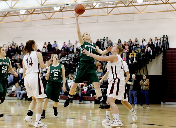 Wyoming East's Megan Davis (11) puts up a jumper over Page Lewis Woodrow Wilson's (22) during their basketball game Monday in Beckley.
