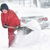 Rick Barbero/The Register-Herald<br /> Mark Dawes, of Beckley, WV, cleans snow off his driveway on Woodlawn Ave. Saturday morning. The winter Storm Jonas blasted the area with approximately 16 inches of snow.