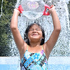 (Brad Davis/The Register-Herald) Seven-year-old Beckley resident Ava Delorso douses herself with chilly water as she and three other siblings spend a hot Friday afternoon trying to stay cool in the fountain at the 2nd Street park. She, sister Alana, 9, and brothers Brayden, 4, and Luis, 5, spent at least a couple of hours splashing around in the fountain, which on a day like yesterday served as more of a giant sprinkler.