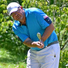 (Brad Davis/The Register-Herald) Paul Hopkins chips onto the green during BNI action Sunday morning at Brier Patch Golf Links.