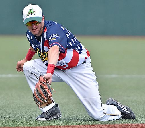 (Brad Davis/The Register-Herald) West Virginia third baseman Taylor Hillson fields a ground ball against Chillicothe Sunday afternoon at Linda K. Epling Stadium.