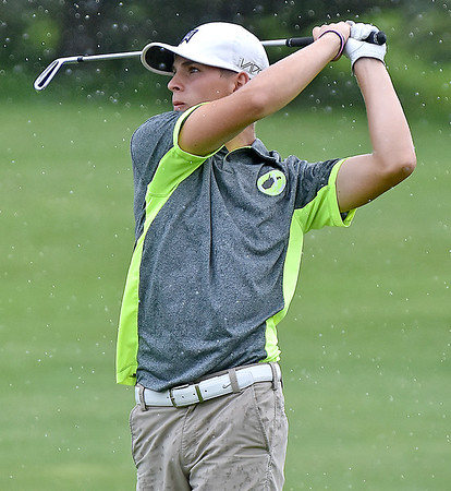 (Brad Davis/The Register-Herald) Landon Perry watches his shot from the no. 18 fairway through a light rain during BNI Classic action Friday afternoon at Brier Patch Golf Links.