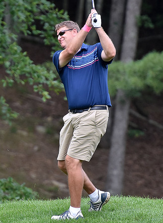 (Brad Davis/The Register-Herald) Chris Daniels shoots from the fairway during Monday's final round of the BNI Monday afternoon on the Cobb Course at Glade Springs.