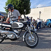 (Brad Davis/The Register-Herald) Beckley resident Harry Church backs his 1966 Yamaha 250cc Big Bear Scrambler into place during the Beckley Cruise-In Car and Bike Show Friday night along Neville Street.