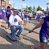 "(Brad Davis/The Register-Herald) MacArthur Walmart employee Robert Norman is pulled and paraded around the Beckley Intermodal Gateway by fellow employee Mona Whitteker on ""The Purple Princess,"" a special, purple toilet that used to make regualr appearances at the event before a few years' hiatus, during the annual Relay For Life event by the American Cancer Society Friday evening. Norman was nominated by friends to take the ride, which he could not get up from until he'd collected at least $50 for cancer research from onlookers. He pulled in over $60."