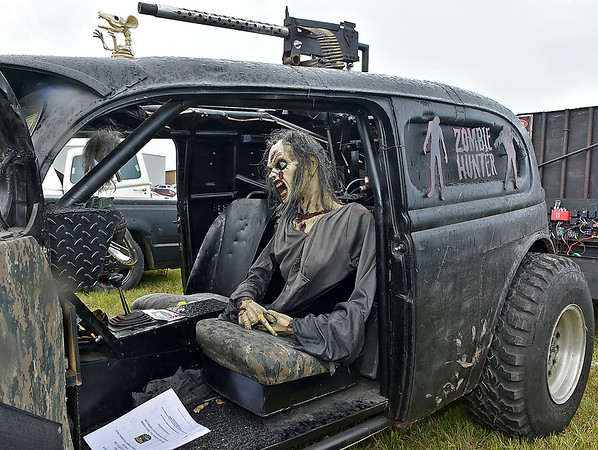 (Brad Davis/The Register-Herald) A ghoulish, zombie hunter-themed vehicle complete with moving zombies sits on display during the Friends of Coal Auto Fair Saturday afternoon at the Raleigh County Memorial Airport.