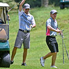 (Brad Davis/The Register-Herald) Brothers Cam, right, and Cole Moore prepare to play from the fairway Sunday morning at Brier Patch Golf Links.