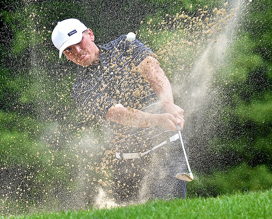 (Brad Davis/The Register-Herald) Tyler Bullington shoots from a bunker on no.18 during Monday's final round of the BNI Monday afternoon on the Cobb Course at Glade Springs.