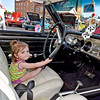 (Brad Davis/The Register-Herald) 1-year-old Karissa Howell is ready to go as she sits behind the wheel of area resident Gerald Doss's 1965 Chevy Chevelle Supersport during the Beckley Cruise-In Car and Bike Show Friday evening along Neville Street.