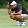 (Brad Davis/The Register-Herald) Derek Brooks sizes up his next putt during BNI Classic action Saturday afternoon at Grandview Golf Course.