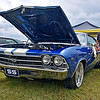 (Brad Davis/The Register-Herald) Shady Spring resident and car owner Kevin Bowling, right, towels off his 1969 Chevelle following another brief rain shower at the Friends of Coal Auto Fair Saturday afternoon at the Raleigh County Memorial Airport.