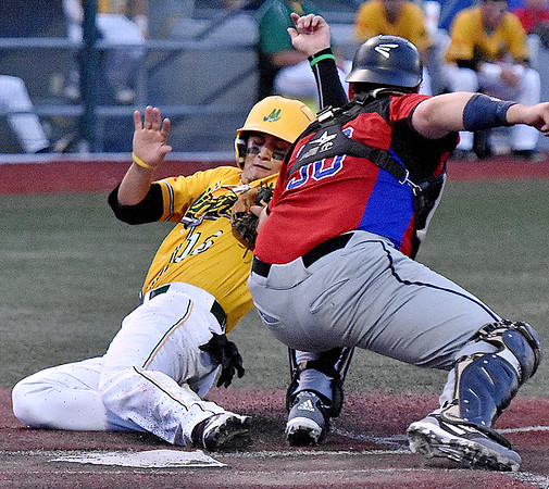 (Brad Davis/The Register-Herald) West Virginia's Anthony Ayala tries to slide around Kings catcher Conor Grove but is tagged out on the play Thursday night at Linda K. Epling Stadium.