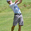 (Brad Davis/The Register-Herald) Cole Moore watches his shot during BNI action Sunday morning at Brier Patch Golf Links.