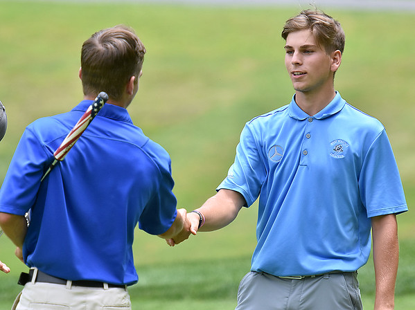 (Brad Davis/The Register-Herald) Runner up Landon Perry, right, congratulates winner Cole Moore, left, following Monday's final round of the BNI Monday afternoon on the Cobb Course at Glade Springs.