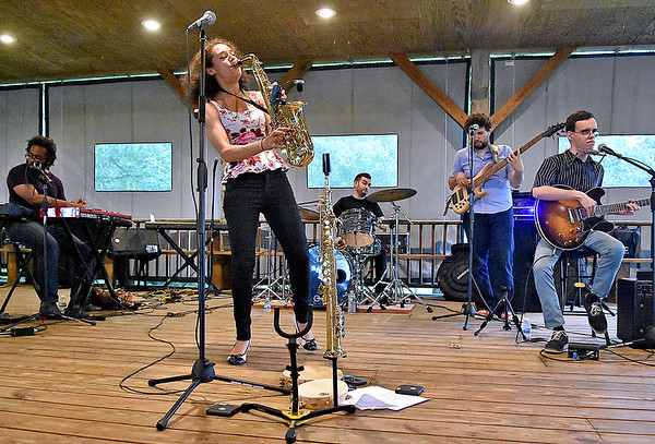 (Brad Davis/The Register-Herald) Maryland-based singer, songwriter and saxophonist Vanessa Collier (singing), performs with her band during a Sax, Blues and BBQ wine and jazz event presented by Simply Jazz & Blues Beckley Thursday night at Daniel Vineyards in Crab Orchard.