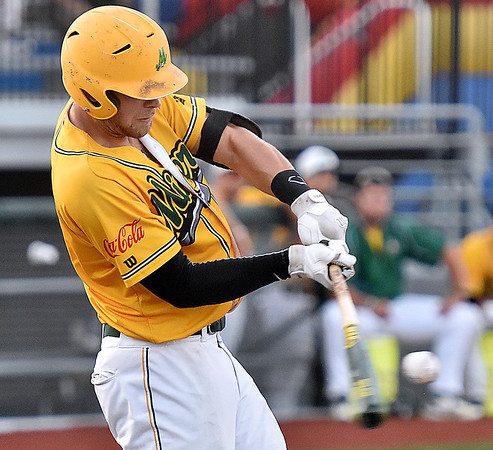 (Brad Davis/The Register-Herald) West Virginia's Dan Ward knocks in a run during the Miners' game against Champion City Thursday night at Linda K. Epling Stadium.