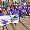 (Brad Davis/The Register-Herald) Cancer survivors begin a three-lap walk around the Beckley Intermodal Gateway to kick off the annual Relay For Life event by the American Cancer Society Friday evening. The first lap was made up of all survivors who were joined by caretakers during the second lap, who were then joined by anyone else who wished to walk with them during the third lap.