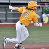 (Brad Davis/The Register-Herald) West Virginia's Nick Delgado knocks in another run during the Miners' game against Champion City Thursday night at Linda K. Epling Stadium.