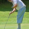 (Brad Davis/The Register-Herald) Roy Forren putts during BNI action Sunday morning at Brier Patch Golf Links.