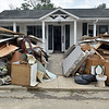 (Brad Davis/The Register-Herald) Large piles of swamped household items and debris are an all too common sight throughout areas in and around Rainelle as cleanup and rebuilding efforts continue two weeks after historic flooding swept through the area.